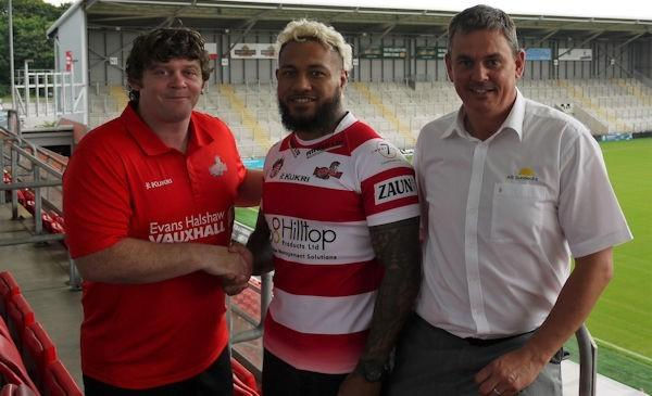 John Duffy and derek Beaumont welcome Junior Sa'u to Leigh