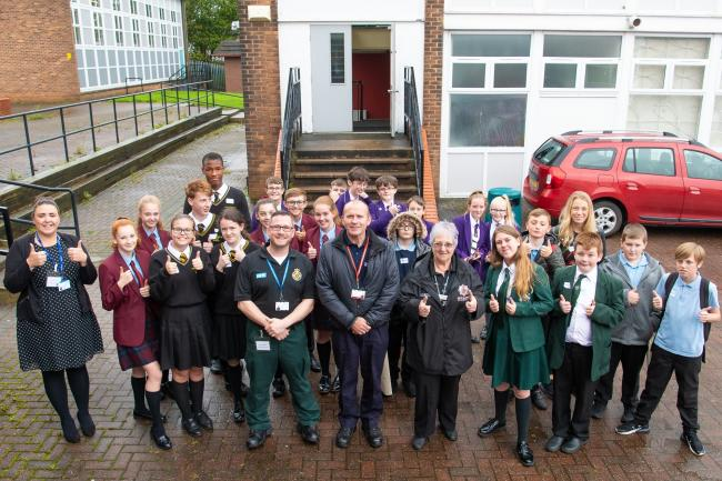 Young people at the safeguarding event with staff from North West Ambulance Service, WWL NHS Foundation trust, Greater Manchester Fire and Rescue Service