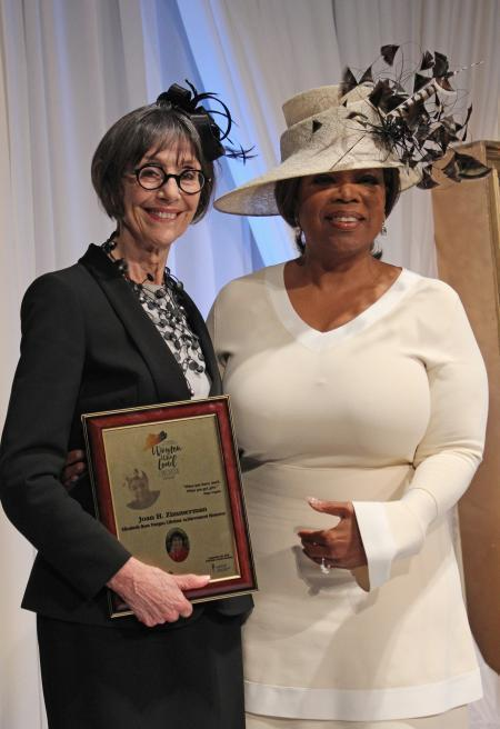 Joan Zimmerman with Oprah Winfrey at the Maya Angelou Women Who Lead Luncheon in North Carolina