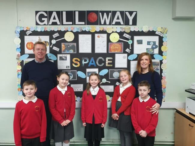 Emily (centre) Emily Wild and members of the school council with class teachers Nick Parr and Becky Southern
