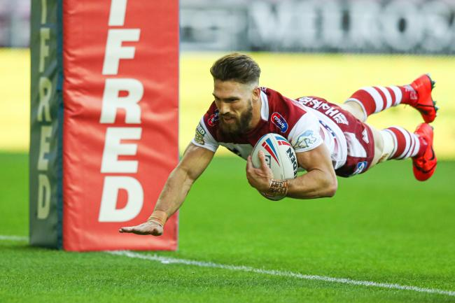 Jarrod Sammut dives over for a Wigan try in Super League last season. Picture: Paul Currie/SWpix.com