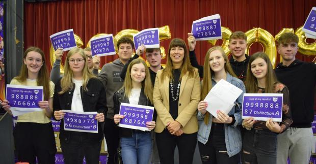 Golborne High School students celebrate their GCSE results last August