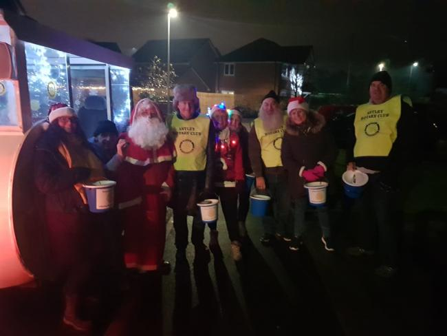 Santa and volunteers during the Rotary Club of Astley street tour in December