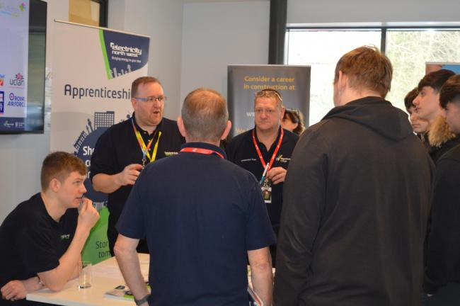 Students gather round a stall at Wigan and Leigh College's career fair