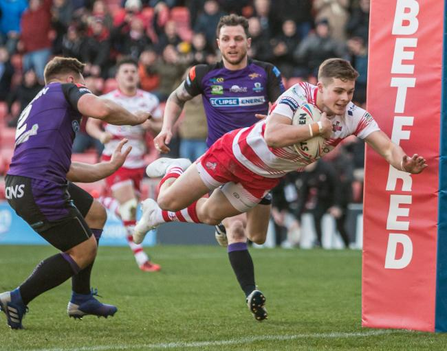Flying wing and Leigh Centurions' hat-trick hero Cameron Scott dives over for a try against Halifax.      Picture: Richard Walker