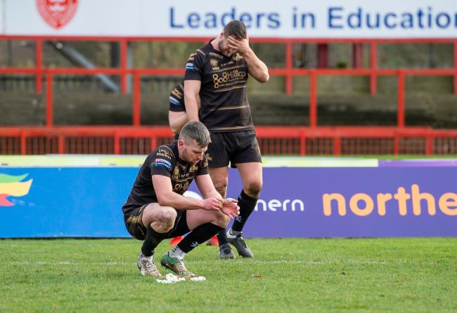Leigh's Greg McNally & Tom Spencer dejected after their loss to Hull KR. Pics: Allan