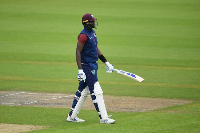 Jason Holder walks off after being dismissed Jason Holder walks off after being dismissed