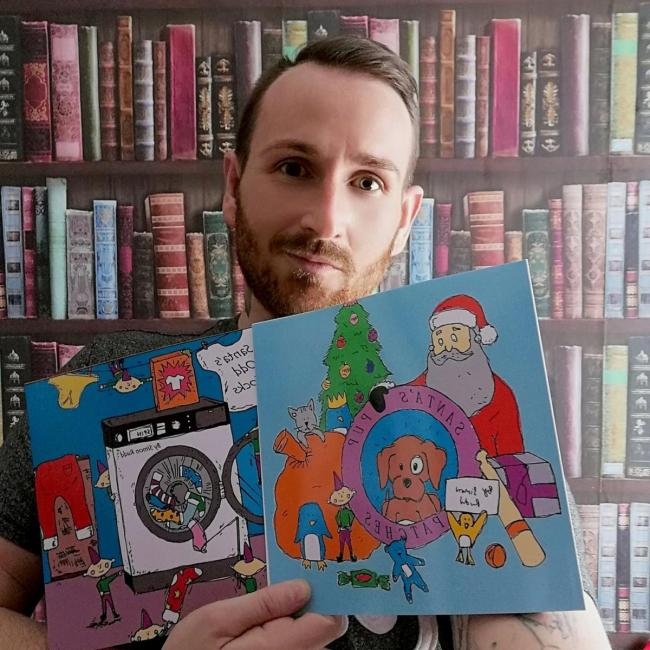 Simon Rudd with his books