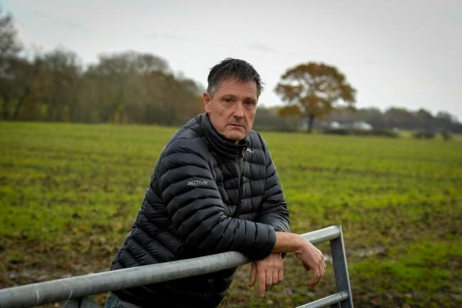 Photograph of Peter Adamson who refuses to sell farm in Carr Lane, Lowton which council wants to develop for housing as part of Greater Manchester spatial framework plans, compulsory purchase order already being used for some of his land where new HS2 lin