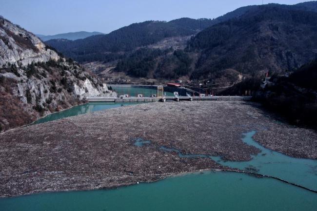 An aerial photo shows rubbish floating in a river in Bosnia