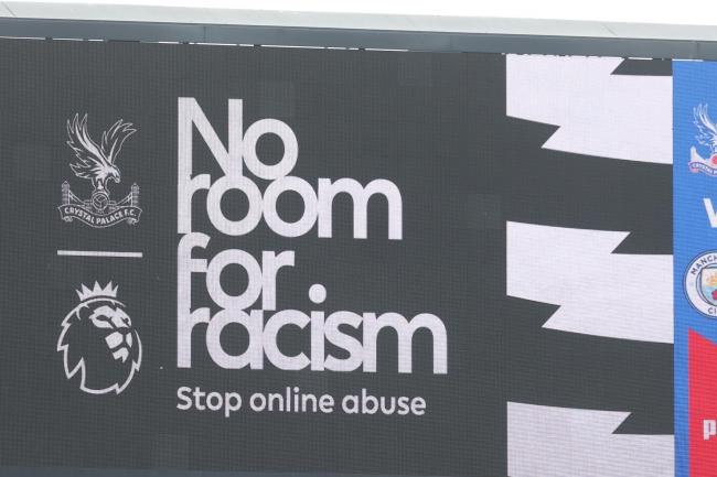 A No room for racism banner