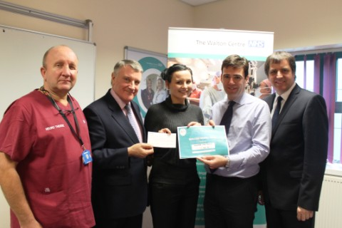 Sarah Davies is thanked by consultant neurosurgeon Paul May, chairman Ken Hoskisson and MPs Andy Burnham and Steve Rotheram at The Walton Centre