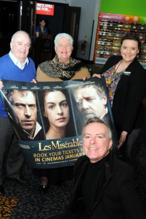 Keith Burns (front) with mum and dad Brian and Veronica and Cineworld Leigh manager Steph Mortimore (right) who provided VIP treatment for them on the opening night of the screening of Les Miserables.