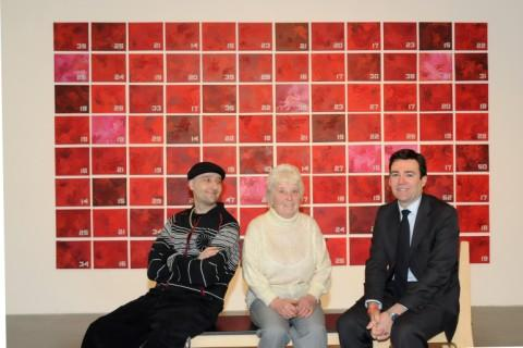 Leigh Journal: Artist Gecko, MP Andy Burnham and Delia Brown admire the artwork at The Turnpike Gallery
