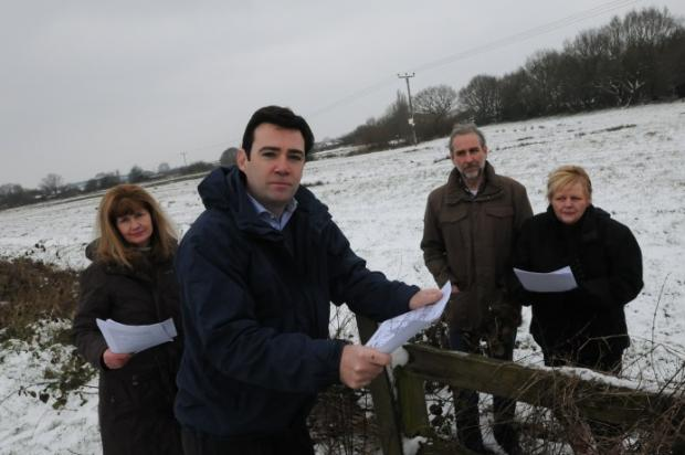 Lowton residents Shelley Kilheeney and Ian Ball voice their concerns over housing plans to MP Andy Burnham (front) and Clr Pam Gillighan (right).