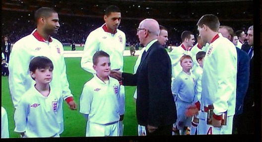 Joe Grainey (front, second from left) on the Wembley pitch as Bobby Charlton greets the England players.