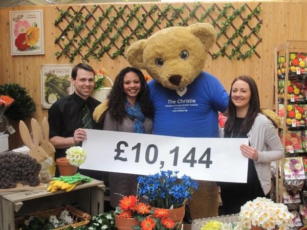 Matthew Dickinson, one of Bents' main charity fundraisers, Angella Rawsthorne from Claire House Children's Hospice, The Christie Bear and Sarah Lee from The Christie at the presentation.