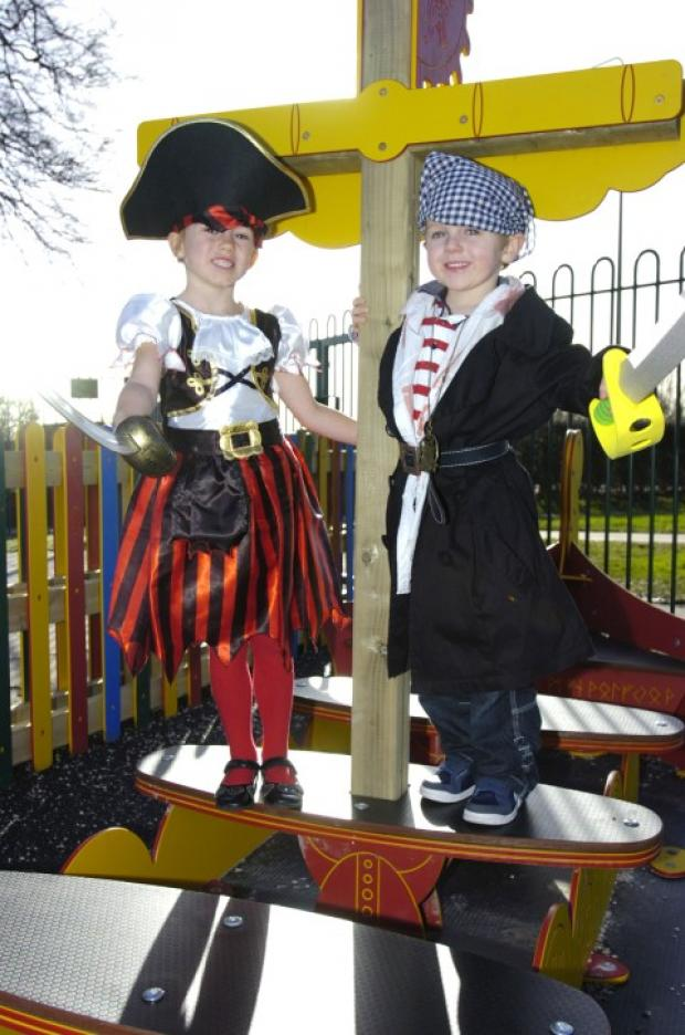 Lily-Mae Leary and Dominic Williams play on their new pirate ship