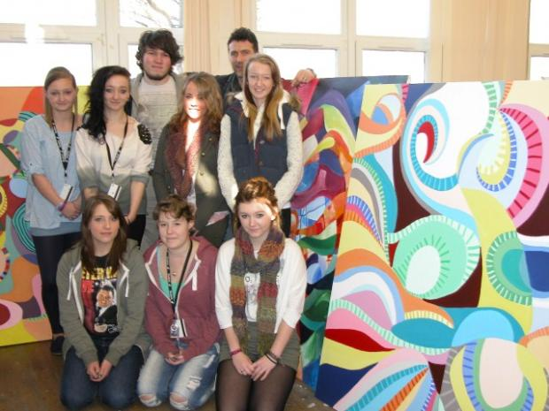 Art students with tutor, Lee Paton, alongside student Lisa Ledgerwood's work.