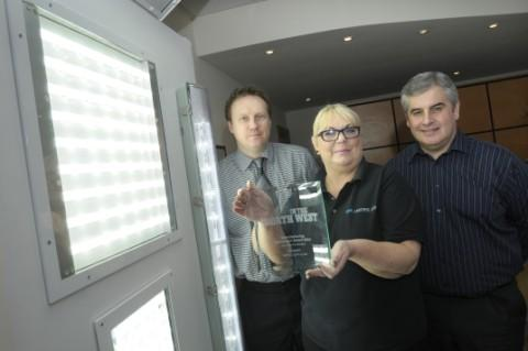 MHA Lighting's John Greenwood, Ann Davies and Darren Bowker with the lighting company's latest award