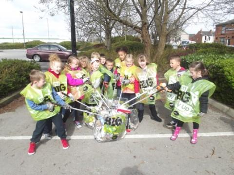 Children in year two help with litter picking