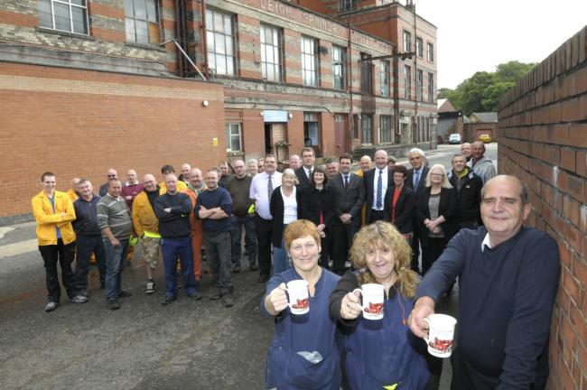 Leigh MP Andy Burnham joins staff at the mill to toast its centenery
