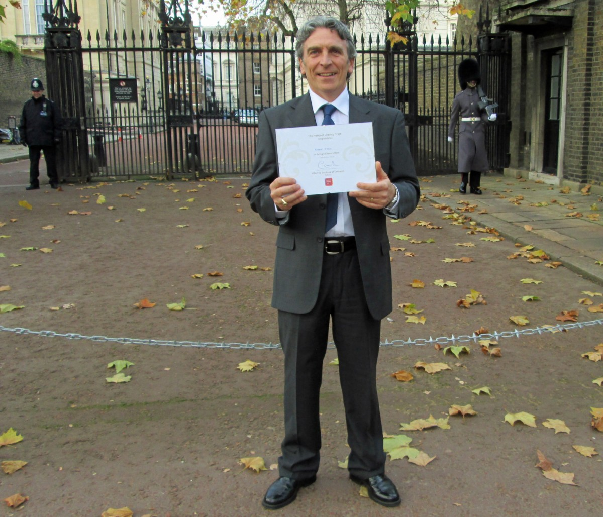 Richard O'Neill with his award outside Clarence House