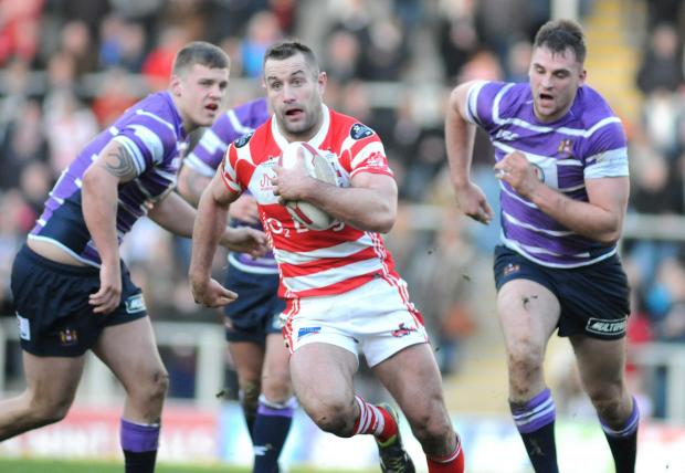 Leigh Journal: Bob Beswick flies clear of the Wigan chasers in Leigh Centurions' first friendly of the year at Leigh Sports Village on Sunday. Unfortunately, Beswick is one of three first-team hookers to be nursing injuries and will not figure against Salford City Red