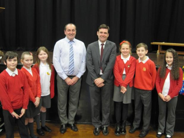 Andy Burnham with head teacher Stephen Callaghan and year six pupils who asked him questions