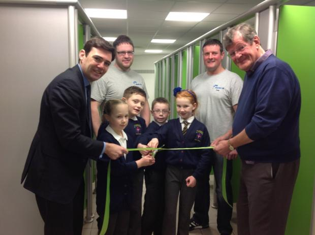 Andy Burnham and pupils from St Georges Primary cut the ribbon