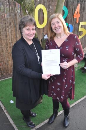 Joint head teachers Michelle Silcock and Alison Davies with the letter from the Minister for Schools