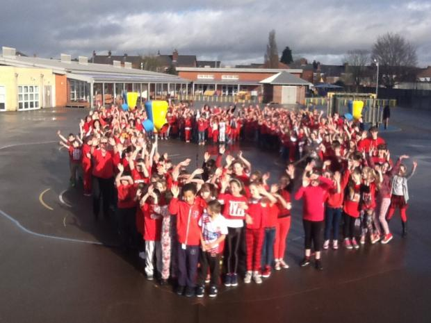 Golborne pupils dressed in red for the British Heart Foundation