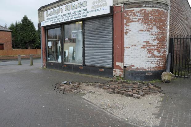 The damage to the paving stones outside Leigh Glass