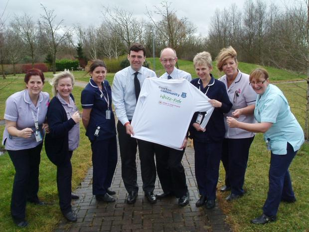 Leigh Journal: Leigh MP Andy Burnham with staff from Wigan and Leigh Hospice