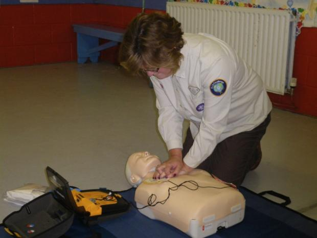 Beaver leader Fiona Glover demonstrates how to use one of the mannequins