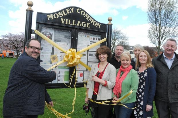 Comedian Justin Moorhouse cut the ribbon for the group's new iron seat and notice board