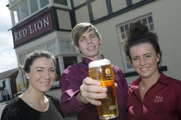 Michelle Peake, Andrew Blakeley and Heather Lynn raise a glass to the newly refurbished Red Lion