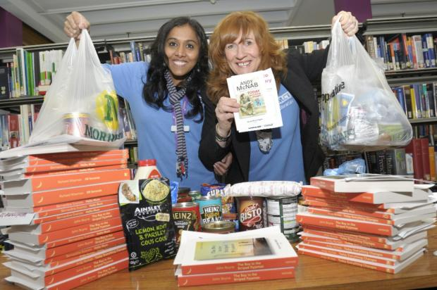 Staff at Leigh Library with the books they donated