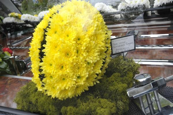 Leigh Journal: Floral tributes at the funeral included this fitting rugby ball