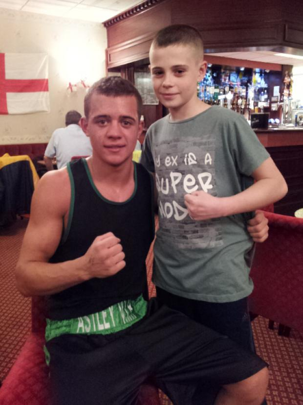 Leigh Journal: West with club mate Kai Pennington following his most recent victory in Manchester this week where he beat the very strong Paulo Guerro