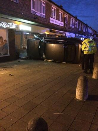 Business as usual after car crashes through pharmacy window