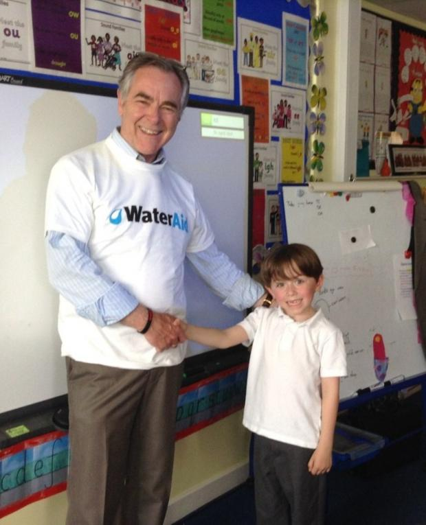 Leigh Journal: Wateraid representative Dave Boughen with Oliver Harrison