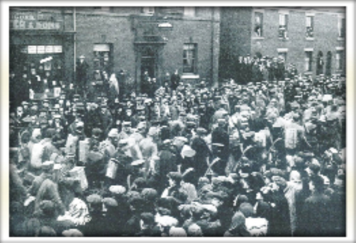 Crowds line King Street in Leigh town centre in 1915 as captured German prisoners of war are escorted towards the canal bridge heading for a camp at Lilford Weaving shed