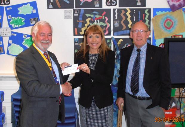 Leigh Rotary president David Jones, Rotarian John Paice with deputy headteacher Anaya Hopkinson