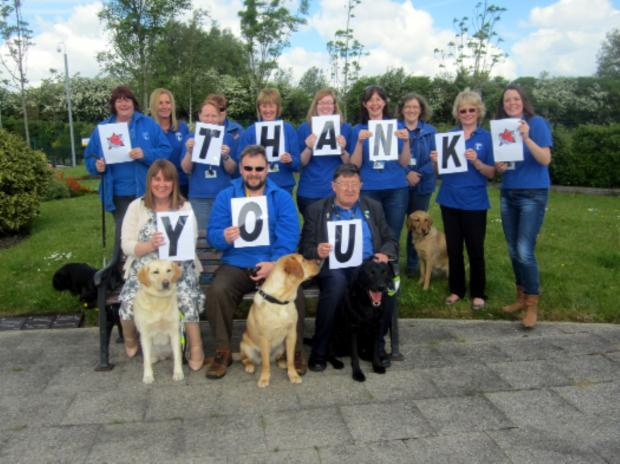 Team members from Guide Dogs say thank you to their volunteers