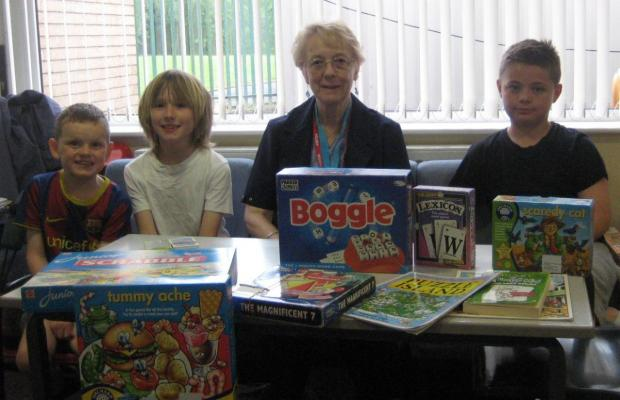 'Reading helper, Alice Priestley, with pupils from Bickershaw CE Primary School