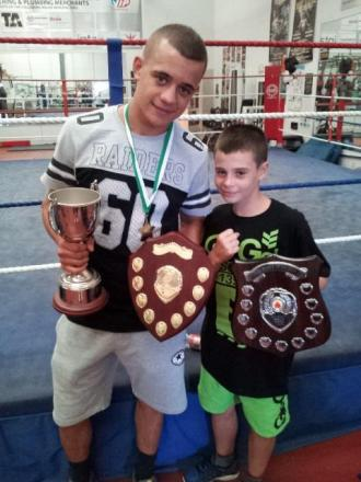 West wins awards on boxing return