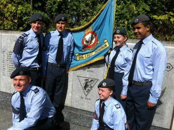 Members of the 316 Squadron Air Cadets with their squadron banner