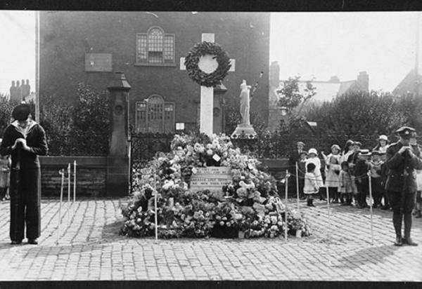 The war memorial outside Top Chapel, Tyldesley, circa 1919 which was later moved to Tyldesley Cemetery (picture courtesy of Wigan Archives and Local Studies)