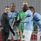 Leigh Journal: Manchester City players remonstrate with referee Istvan Vad after he awarded a penalty against Aleksandar Kolarov, left